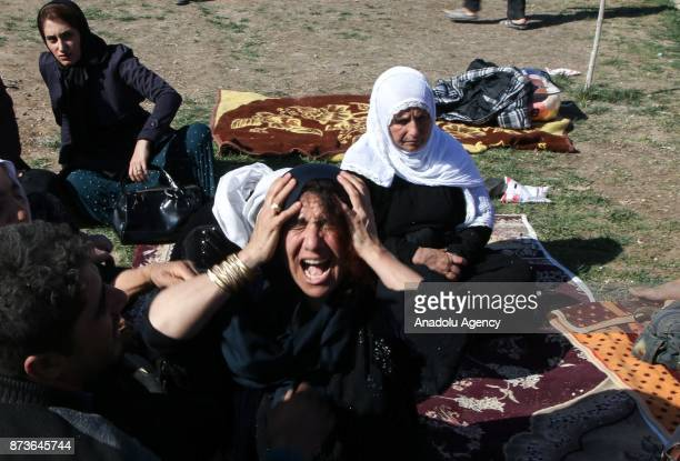 Earthquake survivors who had lost their relatives cry at Sarpole Zahab province of Kermanshah Iran on November 13 2017 following a 73 magnitude...