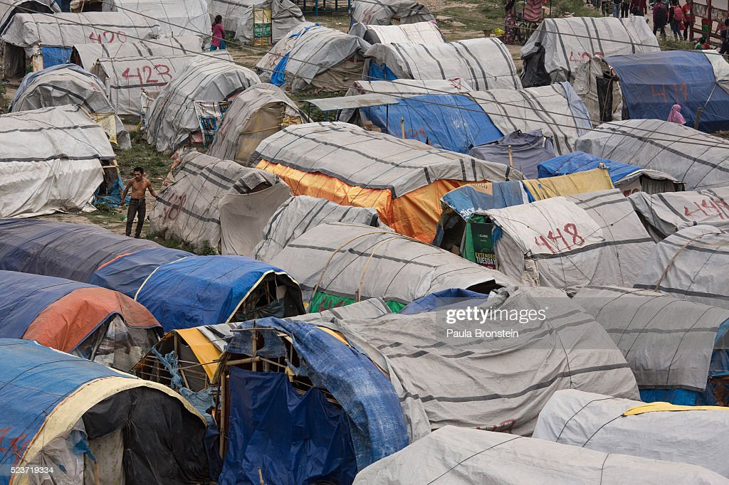 Earthquake victims coming from a far and wide live in a sprawling squalid displaced persons camp for earthquake victims in Kathmandu on April 22, 2016 in Kathmandu, Nepal. The 7.8-magnitude earthquake struck Nepal close to midday on April 25 last year, killing an estimated 9,000 people. Reports suggest the government promised 2,000USD to affected households but has only paid out a fraction of the amount so far and an estimated 660,000 families are still living in sub-standard temporary shelter or unsafe accommodations one year later.