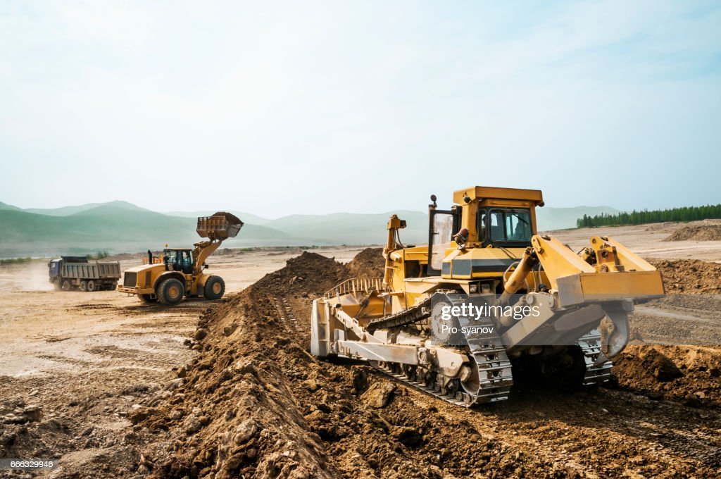 Earthwork, working machinery on a summer day : Stock Photo