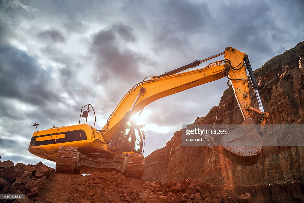 Earthworks with dramatic sky : Stock Photo
