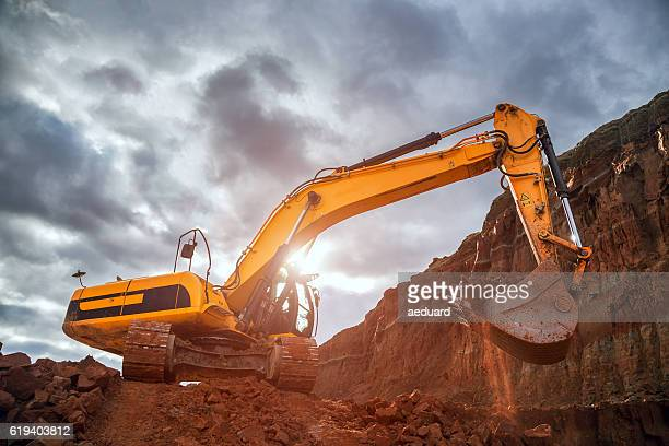 earthworks with dramatic sky - excavator stock photos and pictures