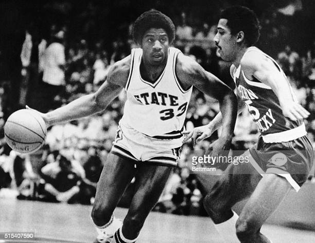 Earvin Johnson a freshman for Michigan State drives past Western Kentucky's Darryl Turner on his way to the basket Michigan led WKO at the half 3929