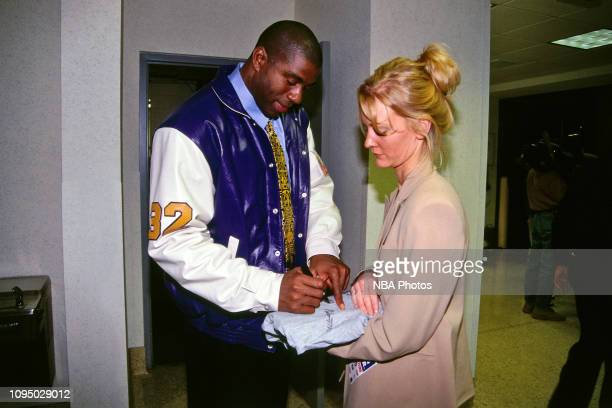 Earvin Johnson signs his autograph for a fan during the NBA at 50 Event on February 7 1997 as a part of NBA AllStar Weekend 1997 at the Gund Arena in...