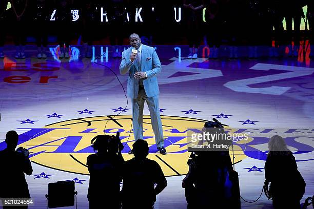 Earvin 'Magic' Johnson addresses the crowd as he pays tribute to Kobe Bryant of the Los Angeles Lakers before Bryant plays his final NBA game at...