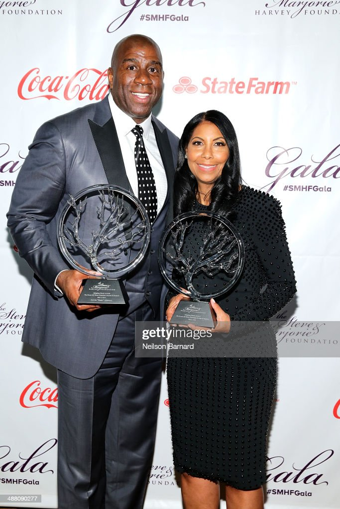 Earvin 'Magic' Johnson and Cookie Johnson poses with their awards at the 2014 Steve & Marjorie Harvey Foundation Gala presented by Coca-Cola at the Hilton Chicago on May 3, 2014 in Chicago, Illinois.