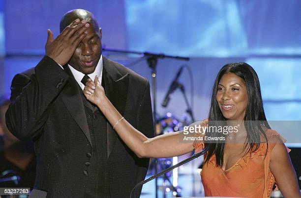 Earvin Magic Johnson and his wife Cookie are seen on stage during the 20th Annual Midsummer Night's Magic Awards Dinner on July 13 2005 at the...
