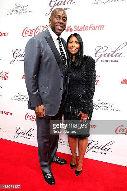 Earvin Magic Johnson and his wife Cookie Johnson attend the 2014 Steve Marjorie Harvey Foundation Gala presented by CocaCola at the Hilton Chicago on...