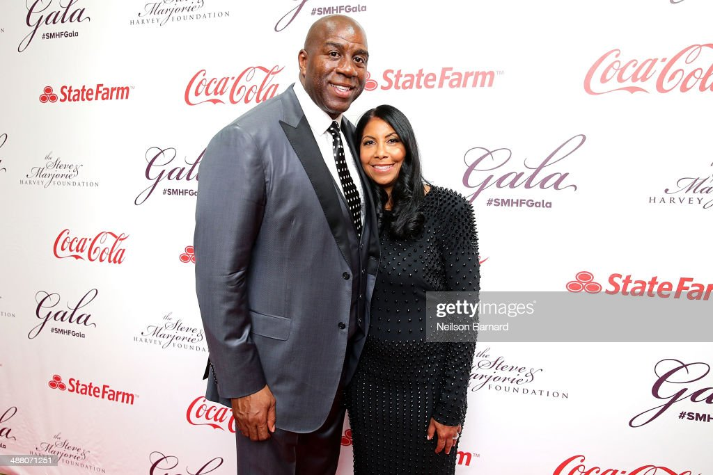 Earvin 'Magic' Johnson and his wife Cookie Johnson attend the 2014 Steve & Marjorie Harvey Foundation Gala presented by Coca-Cola at the Hilton Chicago on May 3, 2014 in Chicago, Illinois.