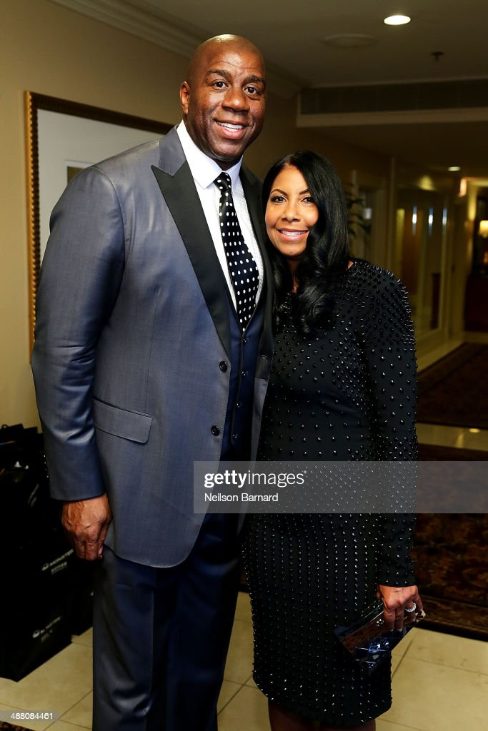Earvin 'Magic Johnson' and his wife Cookie Johnson attend the 2014 Steve & Marjorie Harvey Foundation Gala presented by Coca-Cola VIP Reception at the Hilton Chicago on May 3, 2014 in Chicago, Illinois.