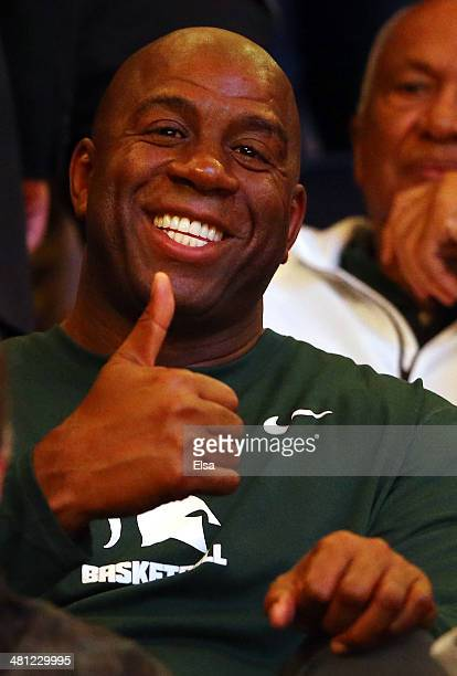 Earvin Magic Johnson gives the thumbs up during the regional semifinal of the 2014 NCAA Men's Basketball Tournament between the Michigan State...