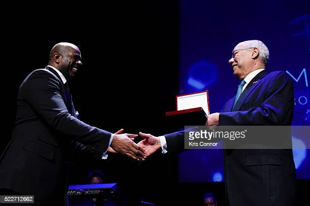 "Earvin ""Magic"" Johnson Jr. Receives an award from Colin Powell during the America's Promise Alliance's Promise Night Gala 2016 at Howard Theatre on..."