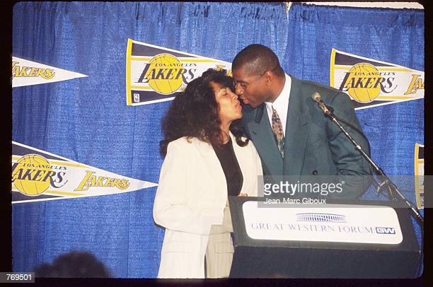 Earvin Magic Johnson kisses his wife at a press conference September 29 1992 in Los Angeles CA Johnson won five championships and three Most Valuable...