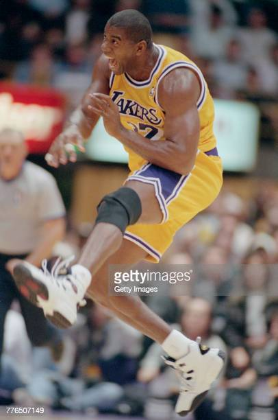 Earvin 'Magic' Johnson of Los Angeles Lakers of the Western Conference celebrates his return to the National Basketball Association during the game...