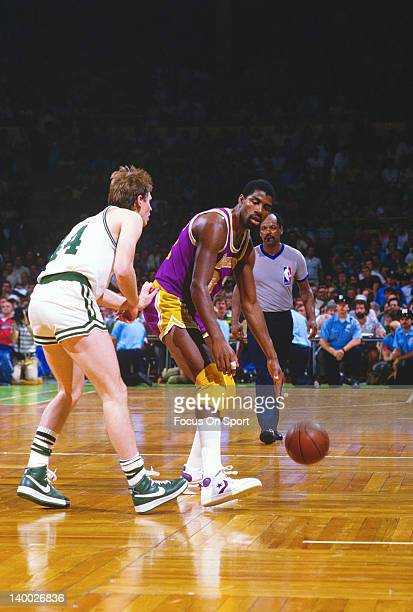 Earvin Magic Johnson of the Los Angeles Lakers dribbles the ball guarded by Danny Ainge of the Boston Celtics during the 1985 NBA Basketball Finals...