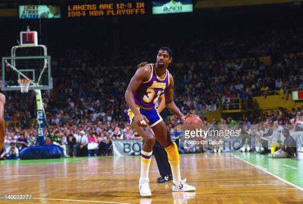 Earvin Magic Johnson of the Los Angeles Lakers dribbles the ball up court against the Boston Celtics during the 1984 NBA Basketball Finals at the...