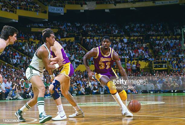Earvin Magic Johnson of the Los Angeles Lakers looks to drive pass Dennis Johnson of the Boston Celtics during the 1985 NBA Basketball Finals at the...