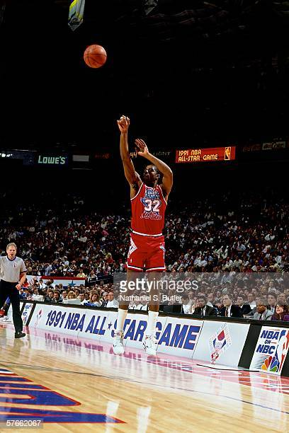 Earvin Magic Johnson of the Western Conference All Stars shoots a jump shot against the Eastern Conference All Stars during the 1991 NBA All Star...