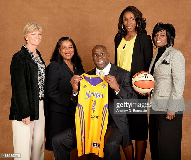 Earvin Magic Johnson poses for a picture with Carol Ross Sparks head coach WNBA President Laurel J Richie Lisa Leslie and Penny Toler during a press...