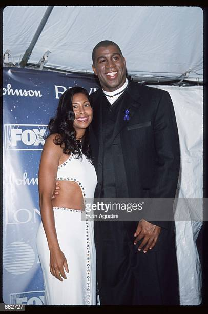 Earvin Magic Johnson poses with his wife Cookie at the Essence Awards April 13 1999 in New York City Johnson won five championships and three Most...