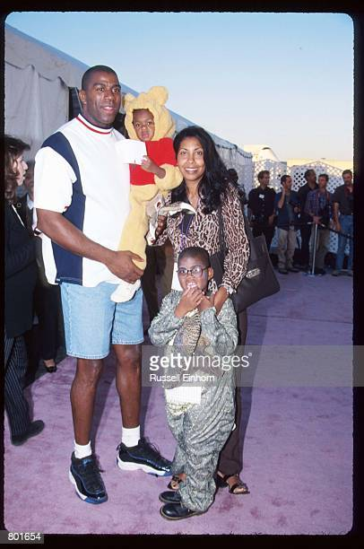 Earvin Magic Johnson poses with his wife Cookie daughter Elisa and son EJ October 25 1997 in Los Angeles CA Johnson won five championships and three...