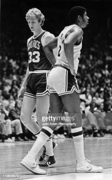 Earvin Magic Johnson rookie for the Los Angeles Lakers with rookie Larry Bird of the Boston Celtics on October 28 play at the Forum in Inglewood...