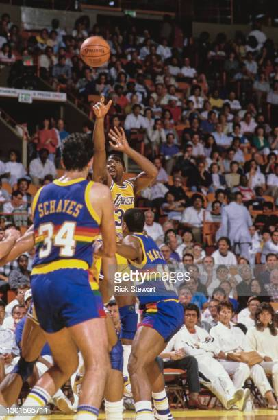 """Earvin """"Magic"""" Johnson, Shooting Guard and Power Forward for the Los Angeles Lakers attempts a jump shot 3 pointer to the basket during the NBA..."""