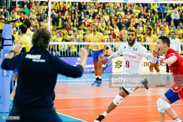Earvin Ngapeth of France celebrates after winning the gold medal match against Brazil at Arena da Baixada Stadium during day five of the FIVB World...