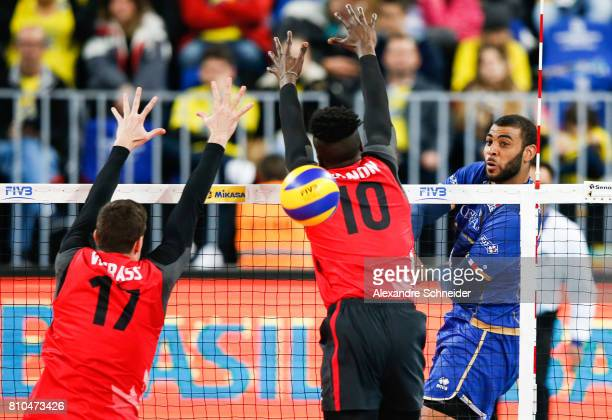 Earvin Ngapeth of France spikes the ball during the semifinal match between France and Canada at Arena da Baixada Stadium during day four of the FIVB...