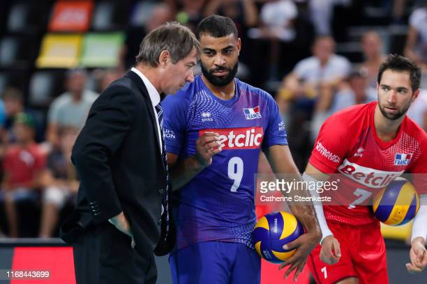 Earvin Ngapeth of France talks to Laurent Tillie Head Coach of France before the Euro Volley 2019 match between Portugal and France on September 15...