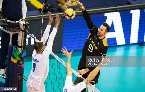 Earvin Ngapeth of Team France and Gyoergy Grozer of the Team Germany in action during the game between France and Germany on january 10, 2020 in...