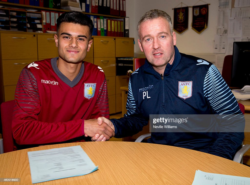 Easah Suliman of Aston Villa poses for a picture with Paul Lambert manager of Aston Villa after signing his first professional contract at the club's training ground at Bodymoor Heath on January 23, 2014 in Birmingham, England.