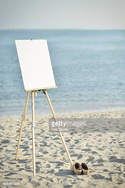 Easel hung on a white canvas