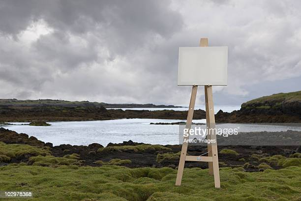 Easel with blank canvas in landscape