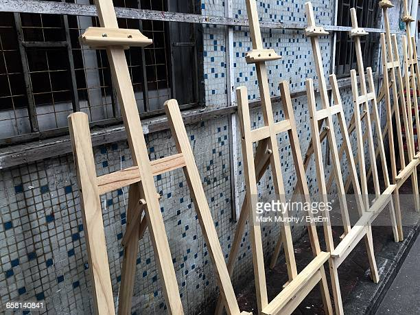 Easels Against Tiled Wall