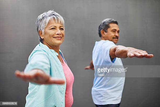 easing into retirement with some yoga - affectionate stock pictures, royalty-free photos & images