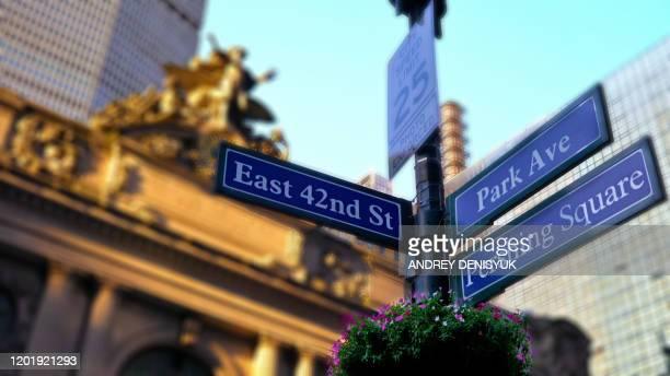 east 42nd, park avenue, pershing square sign. new york city - パークアベニュー ストックフォトと画像