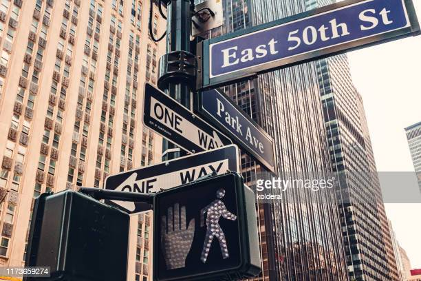 east 50th street and park avenue sign in midtown manhattan - パークアベニュー ストックフォトと画像