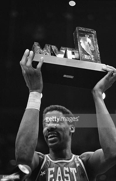 East All Star Julius Erving holds up the Most Valuable Player trophy after the EastWest NBA All Star game at the forum here 2/13 that was won by the...