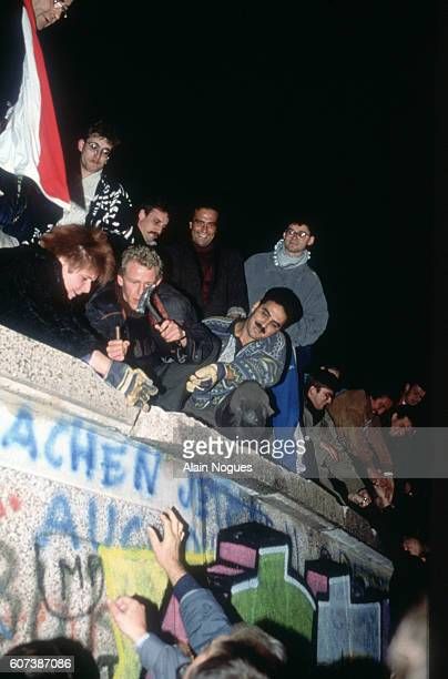 East and West Germans tear down the Berlin Wall on November 9 1989 Berlin had been politically divided since the end of World War II with the eastern...