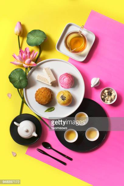 east asian style afternoon tea break objects on pastel background. - moon cake stock pictures, royalty-free photos & images