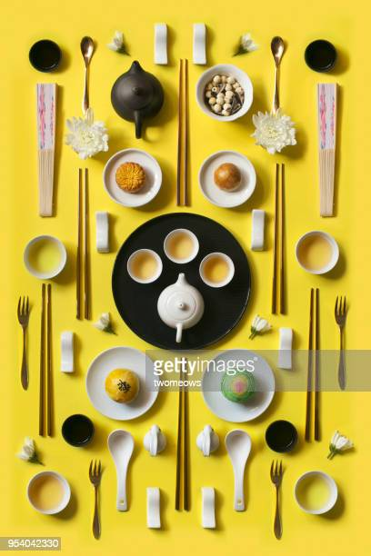 east asian style afternoon tea break objects on yellow colour background. - young animal stock pictures, royalty-free photos & images
