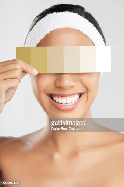 East Asian woman encouraging everyone to see beyond the skin tone of a person