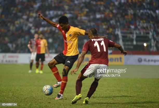 East Bengal's Willis Deon Plaza is tackled by Mohun Bagan's Pronay Halder during an Indian ILeague football match between Mohun Bagan and East Bengal...