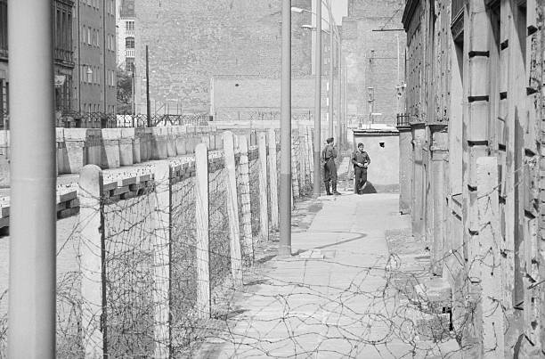 Policemen Guarding Section of Berlin Wall Pictures | Getty Images