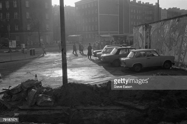 East Berliners at the Berlin Wall prepare to cross to the west after the former East German government lifted travel and emigration restrictions to...