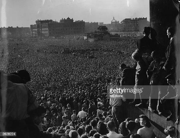 East Berliners gather by the ruins of the Reichstag in an antiCommunist demonstration Russian police opened fire on some of the demostrators who tore...