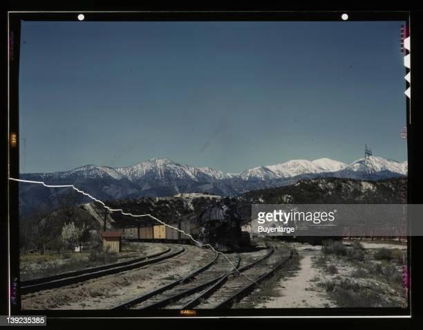 East bound Union Pacific railroad freight train waiting in a siding near the Cajon Pass, Alray, California, 1943.