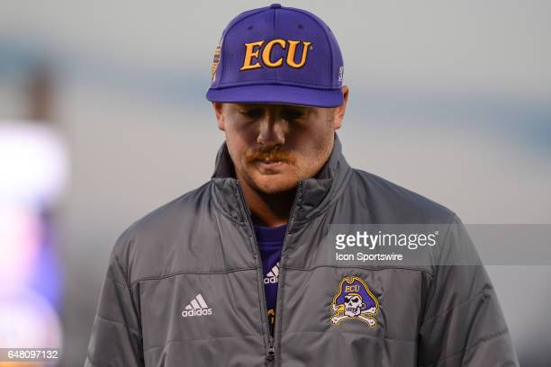 East Carolina assistant coach Parker Lamm walks back to the dugout in a game between the St Johns Red Storm and the East Carolina Pirates during the...