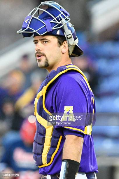East Carolina catcher Travis Watkins between pitches in a game between the St Johns Red Storm and the East Carolina Pirates during the Keith LeClair...