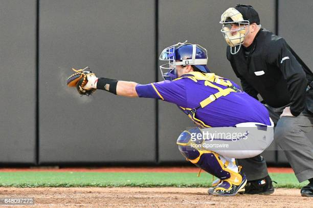 East Carolina catcher Travis Watkins catches a pitch in a game between the St Johns Red Storm and the East Carolina Pirates during the Keith LeClair...